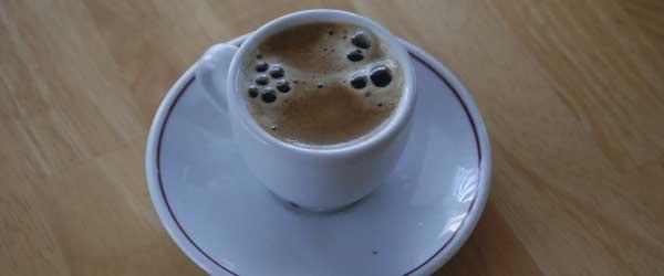Tiny cup o' joe.